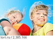 Купить «Две девочки с мячом на фоне неба», фото № 2385166, снято 21 января 2011 г. (c) Gennadiy Poznyakov / Фотобанк Лори