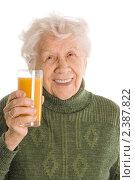 Купить «Старушка со стаканом сока», фото № 2387822, снято 3 марта 2011 г. (c) Воронин Владимир Сергеевич / Фотобанк Лори