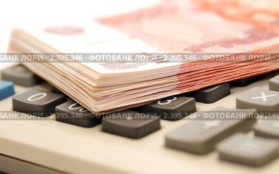 Купить «Деньги и калькулятор», эксклюзивное фото № 2395346, снято 2 марта 2011 г. (c) Юрий Морозов / Фотобанк Лори