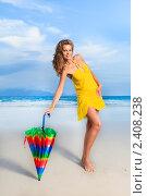 Купить «Девушка с ярким зонтиком  на пляже», фото № 2408238, снято 21 февраля 2011 г. (c) Ольга Хорошунова / Фотобанк Лори