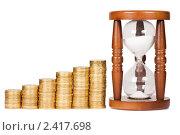 Купить «Песочные часы с монетами на белом фоне», фото № 2417698, снято 19 марта 2011 г. (c) Воронин Владимир Сергеевич / Фотобанк Лори