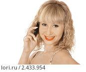 Купить «Молодая женщина с сотовым телефоном на белом фоне», фото № 2433954, снято 25 мая 2018 г. (c) Buka / Фотобанк Лори