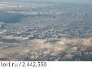 Купить «Облака из иллюминатора самолета», фото № 2442550, снято 31 июля 2010 г. (c) Elena Monakhova / Фотобанк Лори