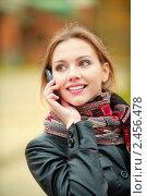 Купить «Красивая молодая женщина говорит по телефону», фото № 2456478, снято 11 октября 2010 г. (c) BestPhotoStudio / Фотобанк Лори