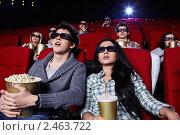 Купить «Молодая пара в кино», фото № 2463722, снято 1 марта 2011 г. (c) Raev Denis / Фотобанк Лори