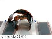 Купить «Фотопленка на белом фоне», фото № 2478014, снято 9 апреля 2011 г. (c) Алексей Романцов / Фотобанк Лори