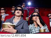 Купить «Молодые люди в кинотеатре», фото № 2491654, снято 1 марта 2011 г. (c) Raev Denis / Фотобанк Лори