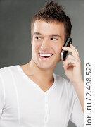 Купить «Молодой человек говорит по мобильному телефону», фото № 2498522, снято 10 ноября 2010 г. (c) BestPhotoStudio / Фотобанк Лори