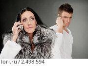Купить «Юноша и взрослая женщина говорят по телефону», фото № 2498594, снято 10 ноября 2010 г. (c) BestPhotoStudio / Фотобанк Лори