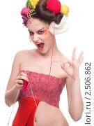 Купить «Девушка  с клубками пряжи и спицами в волосах», фото № 2506862, снято 24 марта 2010 г. (c) Александр Маркин / Фотобанк Лори