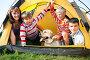 Счастливая семья в туристической палатке с собакой, фото № 2533078, снято 24 октября 2016 г. (c) Коваль Василий / Фотобанк Лори