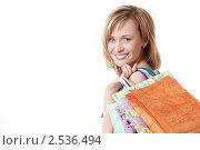 Купить «Девушка с покупками», фото № 2536494, снято 2 апреля 2011 г. (c) Raev Denis / Фотобанк Лори