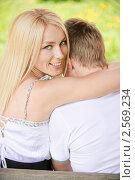 Купить «Молодая пара на скамейке», фото № 2569234, снято 22 мая 2010 г. (c) BestPhotoStudio / Фотобанк Лори