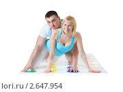 Влюбленная пара играет в Твистер. Стоковое фото, фотограф Ольга Красавина / Фотобанк Лори