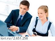 Купить «Деловые люди за работой в офисе», фото № 2651258, снято 9 августа 2009 г. (c) Андрей Зык / Фотобанк Лори