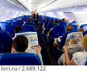 Купить «Работа стюарда на борту авиалайнера», фото № 2689122, снято 28 мая 2011 г. (c) Александр Подшивалов / Фотобанк Лори