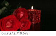 Купить «Горящая свеча и красная роза на черном фоне», видеоролик № 2710678, снято 7 марта 2010 г. (c) ILLYCH / Фотобанк Лори