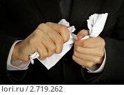 Купить «Деловой человек яростно терзает бумагу», фото № 2719262, снято 23 ноября 2010 г. (c) pzAxe / Фотобанк Лори
