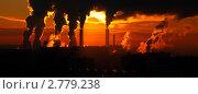 Купить «Трубы ТЭЦ с дымом на фоне оранжевого неба», фото № 2779238, снято 1 декабря 2010 г. (c) Александр Косарев / Фотобанк Лори