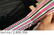 Купить «Плетение пояса из разноцветных нитей», видеоролик № 2800350, снято 16 сентября 2011 г. (c) Милана Харитонова / Фотобанк Лори