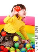 Купить «Девочка в детском бассейне с шариками», фото № 2848982, снято 6 февраля 2010 г. (c) Gennadiy Poznyakov / Фотобанк Лори