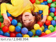Купить «Девочка в детском бассейне с шариками», фото № 2848994, снято 6 февраля 2010 г. (c) Gennadiy Poznyakov / Фотобанк Лори