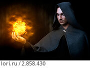 Купить «Маг огня кастует файербол. Мужской костюм для  хэллоуина», фото № 2858430, снято 1 сентября 2011 г. (c) katalinks / Фотобанк Лори