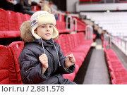 Купить «Мальчик сидит на трибунах стадиона», фото № 2881578, снято 20 февраля 2010 г. (c) Losevsky Pavel / Фотобанк Лори