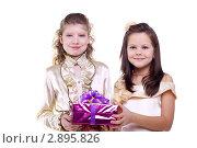 Купить «Подружки с подарком», фото № 2895826, снято 5 ноября 2010 г. (c) lanych / Фотобанк Лори