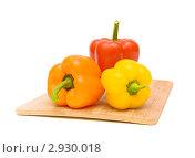 Купить «Три сладких перца разного цвета на белом фоне», фото № 2930018, снято 5 ноября 2011 г. (c) Ласточкин Евгений / Фотобанк Лори