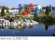 Купить «Красивый пруд с декоративными рыбами и детская площадка.У бензозаправочной станции. Чехия.», фото № 2930722, снято 4 октября 2011 г. (c) Федор Королевский / Фотобанк Лори