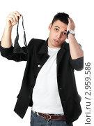 Купить «Молодой привлекательный мужчина показывает черные женские трусики, схватившись за голову», фото № 2959586, снято 3 февраля 2010 г. (c) Сергей Сухоруков / Фотобанк Лори
