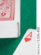 """Купить «Колода игральных карт и символ """"червы"""" на карте», фото № 3036450, снято 21 июня 2007 г. (c) Monkey Business Images / Фотобанк Лори"""