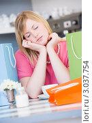 Купить «Портрет уставшей после шоппинга девушки в кафе», фото № 3037754, снято 22 января 2007 г. (c) Monkey Business Images / Фотобанк Лори