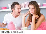 Купить «Ссора между молодыми супругами за завтраком», фото № 3038038, снято 22 января 2007 г. (c) Monkey Business Images / Фотобанк Лори