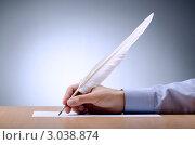 Купить «Человек пишет ручкой в виде пера на бумаге на градиентном фоне», фото № 3038874, снято 1 ноября 2011 г. (c) Elnur / Фотобанк Лори
