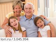 Купить «Счастливые бабушка и дедушка с внуками на диване», фото № 3045994, снято 26 июня 2007 г. (c) Monkey Business Images / Фотобанк Лори