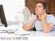 Купить «Мужчина в офисе сидит перед вентилятором охлаждения», фото № 3049550, снято 12 января 2007 г. (c) Monkey Business Images / Фотобанк Лори