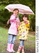 Купить «Девочки в резиновых сапогах и плащах вместе стоят под одним зонтом», фото № 3055650, снято 7 июня 2006 г. (c) Monkey Business Images / Фотобанк Лори