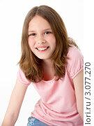 Купить «Портрет радостной девочки в розовой майке, белый фон», фото № 3077270, снято 4 апреля 2009 г. (c) Monkey Business Images / Фотобанк Лори
