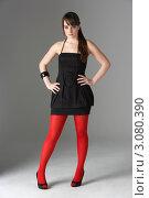 Купить «Стильная девушка в черном платье и красных колготках», фото № 3080390, снято 20 апреля 2009 г. (c) Monkey Business Images / Фотобанк Лори
