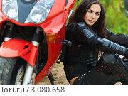 Купить «Молодая темноволосая  женщина  сидит рядом  с  мотоциклом», фото № 3080658, снято 17 июля 2011 г. (c) BestPhotoStudio / Фотобанк Лори
