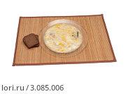 Купить «Тарелка супа и ломтики ржаного хлеба на бамбуковой салфетке», фото № 3085006, снято 13 декабря 2011 г. (c) Андрей Некрасов / Фотобанк Лори