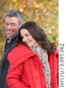 Купить «Мужчина и женщина стоят спиной друг ко другу, портрет в осеннем парке», фото № 3091062, снято 17 октября 2009 г. (c) Monkey Business Images / Фотобанк Лори