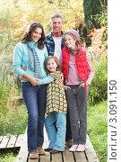 Купить «Портрет счастливой семьи на прогулке в осеннем лесу», фото № 3091150, снято 18 октября 2009 г. (c) Monkey Business Images / Фотобанк Лори