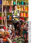 Купить «Молодая улыбающаяся женщина сидит в комнате среди разноцветной пряжи и ниток», фото № 3093022, снято 24 ноября 2009 г. (c) Monkey Business Images / Фотобанк Лори