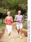 Купить «Пожилая пара совершает пробежку по парку», фото № 3106722, снято 31 августа 2010 г. (c) Monkey Business Images / Фотобанк Лори