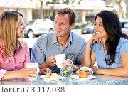 Купить «Трое друзей общаются за столиком кафе на улице», фото № 3117038, снято 11 мая 2011 г. (c) Monkey Business Images / Фотобанк Лори