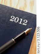 Купить «Крупно фрагмент датированного ежедневника на 2012 год и перьевой ручки», фото № 3123506, снято 11 августа 2011 г. (c) Monkey Business Images / Фотобанк Лори