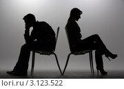 Купить «Силуэты мужчины и женщины в ссоре, сидящих на стульях спинками друг к другу», фото № 3123522, снято 21 июля 2011 г. (c) Monkey Business Images / Фотобанк Лори